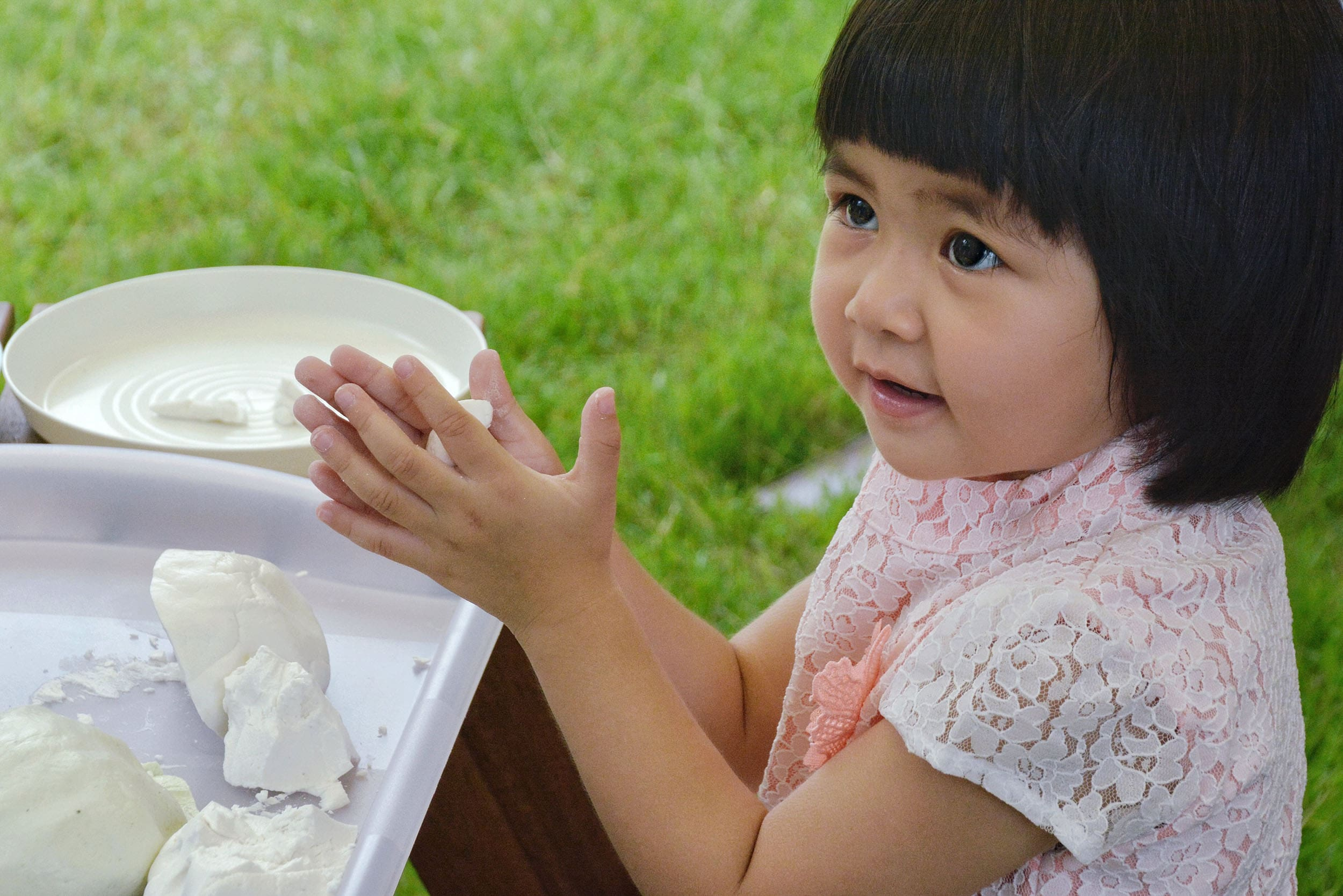 Pre-K students learn how to make their own floating krathong baskets to celebrate the Thai Loy Krathong festival